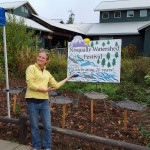 Morgan Greene welcomes guests to the 26th annual Nisqually Watershed Festival