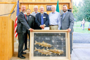 NRF board members David Troutt, Fred Michelson, Bill Bryant, and honoree Jim Wilcox stand with Gov. Dan Evans and Executive Director Justin Hall with salmon artwork for Jim's award.